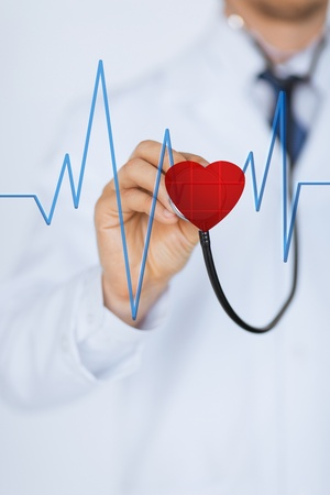 doctor with stethoscope listening heart beat on virtual screen photo