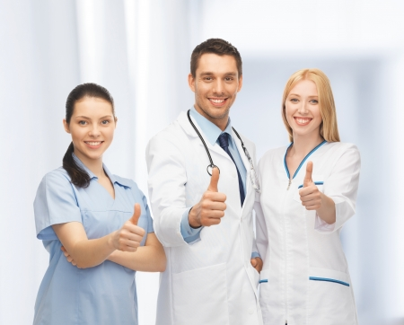 physiotherapists: professional young team or group of doctors showing thumbs up Stock Photo