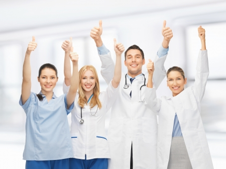 professional young team or group of doctors showing thumbs up photo