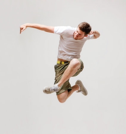 cool boys: picture of male dancer jumping in the air Stock Photo