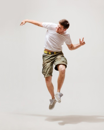 picture of male dancer jumping in the air photo