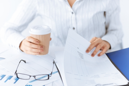 picture of woman hands working with blank paper and drinking coffee photo