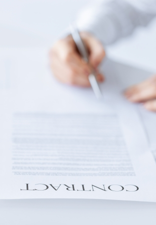 new contract: closeup picture of woman hands signing contract Stock Photo