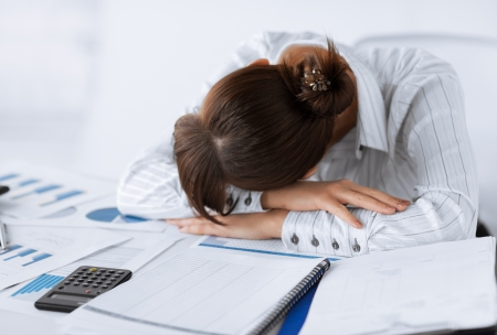 picture of tired woman sleeping at work