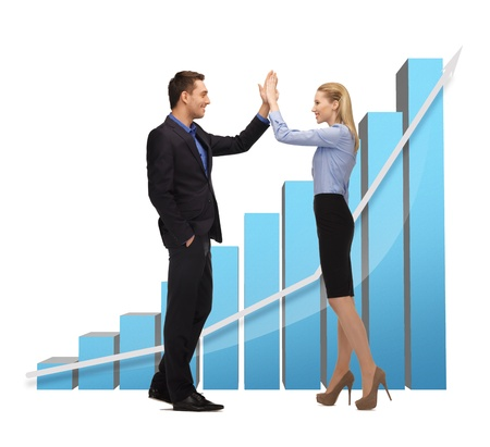 winning stock: bright picture of man and woman giving a high five. Stock Photo
