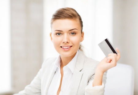 businesswoman card: bright picture of smiling businesswoman showing credit card