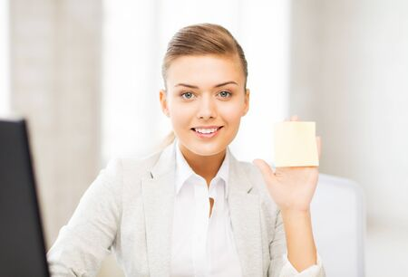 picture of smiling businesswoman showing sticky note photo