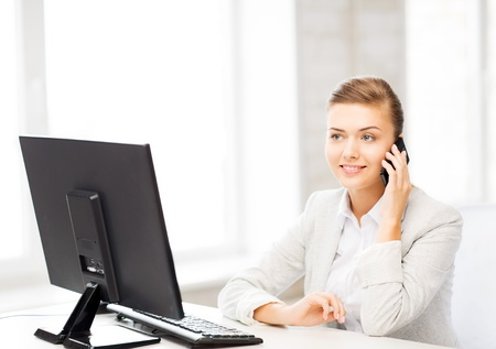 picture of smiling businesswoman with smartphone in office Stock Photo - 20610744