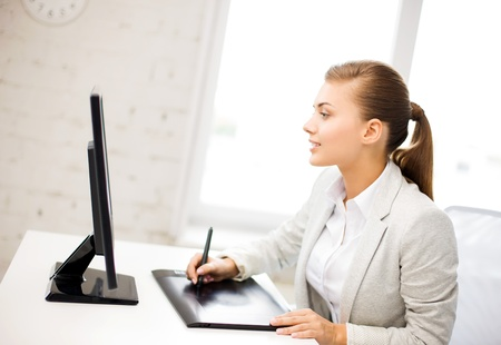 retouch: picture of smiling businesswoman with drawing tablet in office