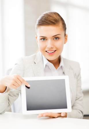 picture of smiling businesswoman with tablet pc in office photo