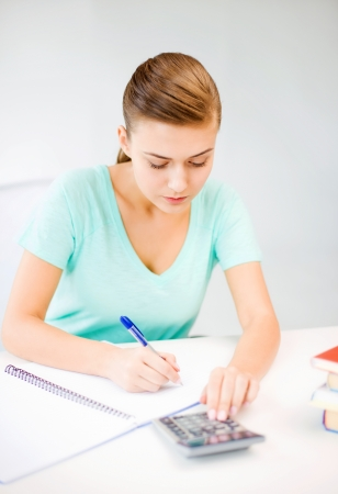 picture of student girl with notebook and calculator photo