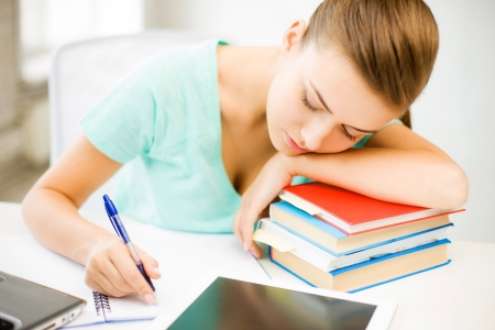 sleeping tablets: picture of tired student sleeping on stock of books