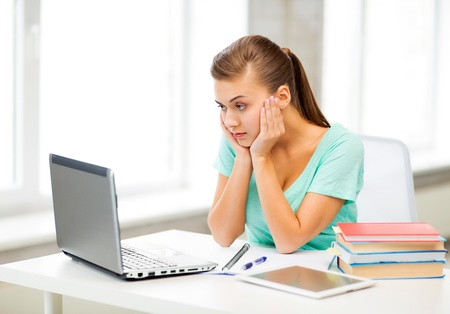 distance: picture of stressed student with computer at home