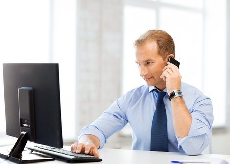 telephone salesman: picture of smiling businessman with smartphone in office Stock Photo