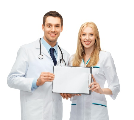 bright picture of two young attractive doctors photo