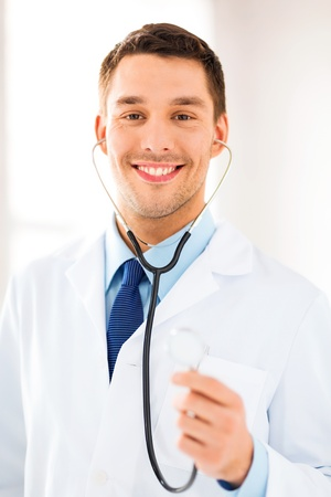 bright picture of male doctor with stethoscope photo