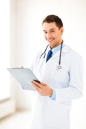 doctor writing: bright picture of male doctor writing prescription Stock Photo