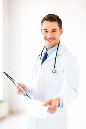 bright picture of male doctor writing prescription photo