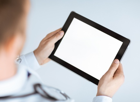 close up of male doctor hands holding tablet pc