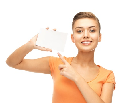 picture of smiling woman pointing at white blank card
