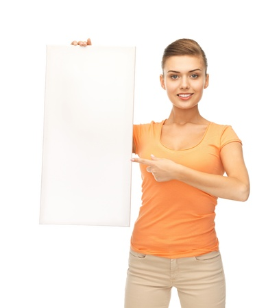 happy smiling woman pointing at white blank board photo