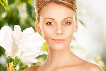 picture of beautiful woman with madonna lily flower photo