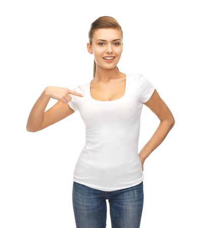 tshirts: picture of smiling woman pointing at blank white t-shirt Stock Photo