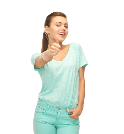 picture of smiling girl in color t-shirt showing thumbs up Stock Photo - 20610960
