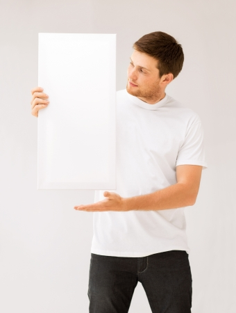 big picture: picture of young man holding white blank board Stock Photo