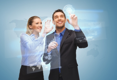 digi: picture of two business people working with virtual screen Stock Photo