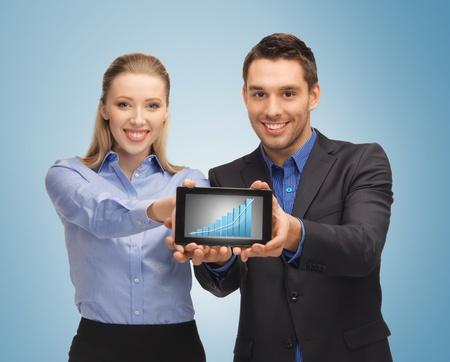 picture of two business people showing tablet pc with graph photo