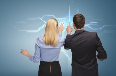 picture of man and woman working with virtual screen photo