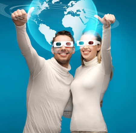 holography: picture of woman and man in 3d glasses looking at globe model