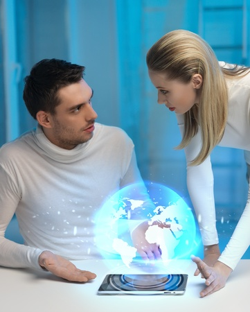 lab tech: picture of futuristic man and woman with globe hologram