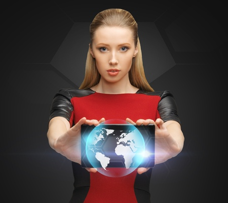picture of woman holding tablet pc with sign of globe photo