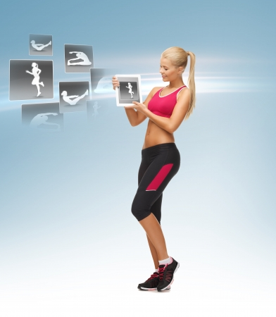 beautiful woman holding tablet pc with sport application photo