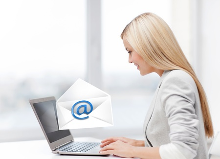 picture of beautiful woman with laptop computer sending email Stock Photo