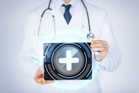 close up of male doctor holding tablet pc with medical app photo