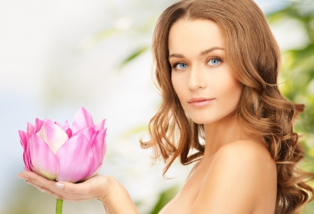 beautiful face: picture of lovely woman with lotos flower
