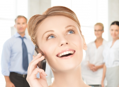 calling on phone: picture of businesswoman with cell phone calling