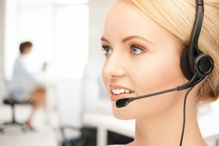business communication: bright picture of friendly female helpline operator