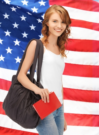 bright picture of travelling student with bag and book over american flag photo