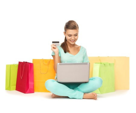 emoney: woman with laptop, shopping bags and credit card