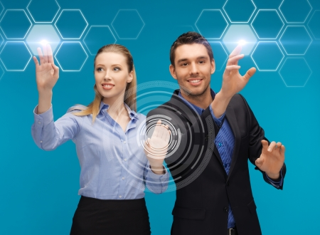 picture of man and woman working with virtual screen Banco de Imagens