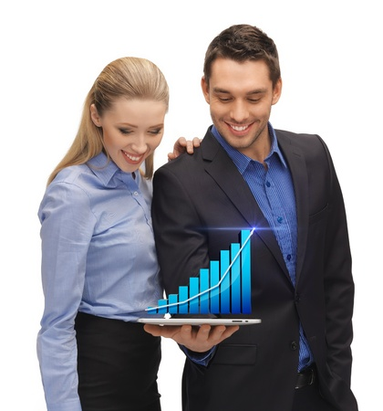 two business people showing tablet pc with hologram of graph