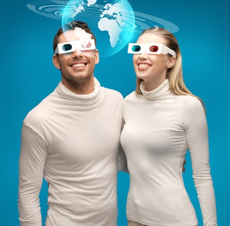 picture of woman and man in 3d glasses looking at globe model photo
