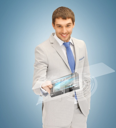 picture of businessman with tablet pc and virtual screen photo