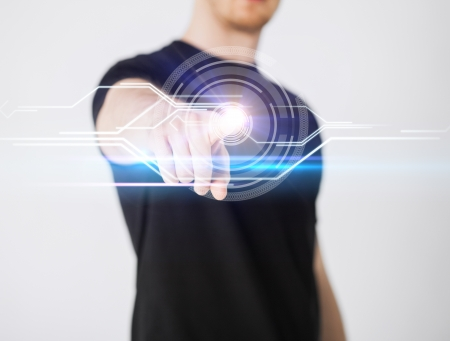 digi: close up of male hand touching virtual screen Stock Photo