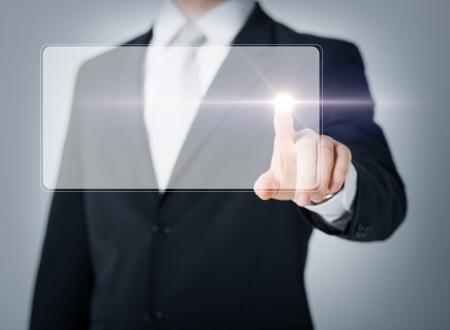 digi: close up of male hand touching virtual screen Stock Photo
