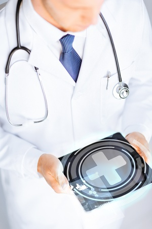 high tech device: close up of male doctor holding tablet pc with medical app Stock Photo